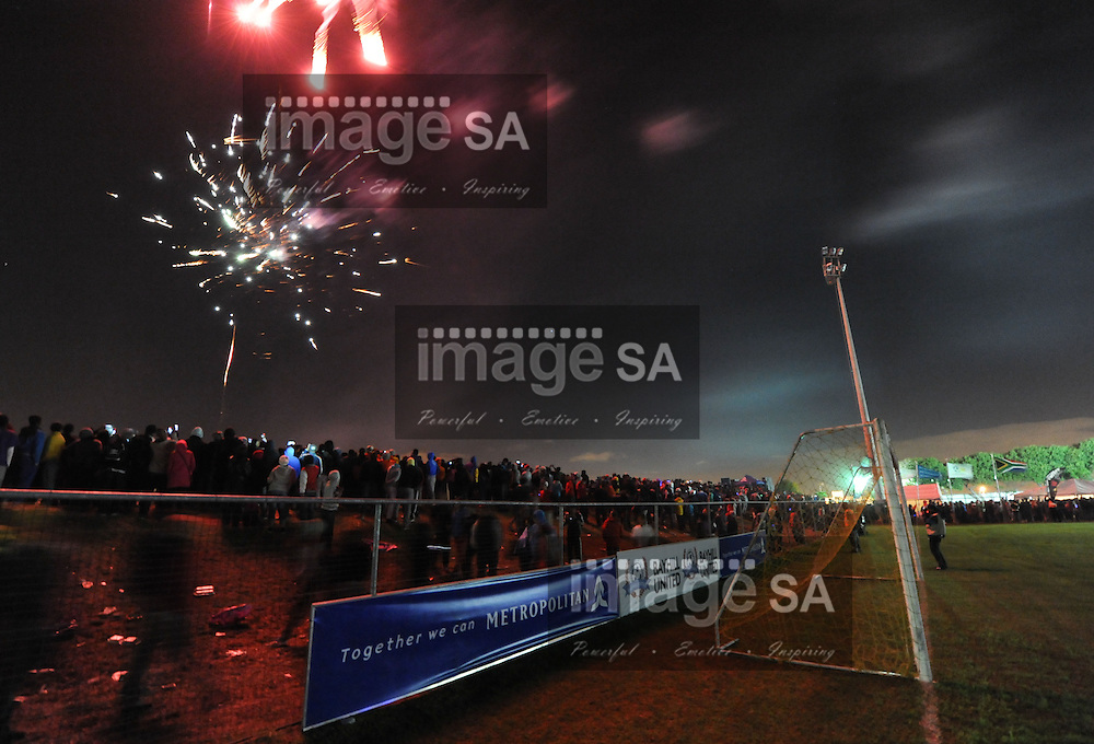 CAPE TOWN, South Africa - Friday 29 March 2013, fireworks explode overhead during the opening ceremony of the 25th Metropolitan Premier Cup soccer tournament taking place at Erica Park Sports Complex in Belhar..Photo by Roger Sedres/ ImageSA