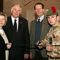 Launch of Black Watch drop in centre in Perth for the families of the Regiments soldiers who are currently deplyed in Iraq.<br />L/Cpl Alan Ferrier of the 1st Battalion The Black Watch cuts the ribbon watched by from left Alison Lowson, Editor of the Perthshire Advertiser, Provost Bob Scott, Lt Col Stepehn Lindsay, Black Watch Regimental Secretary.<br />see story by Maureen Young Tel: 01764 663191 / 07778 779888<br />Picture by Graeme Hart.<br />Copyright Perthshire Picture Agency<br />Tel: 01738 623350  Mobile: 07990 594431