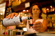 A shot of bitters is poured at Nelsen's Hall on Washington Island in Door County, Wisconsin.  Having a shot of bitters is tradition at the bar.  (Mike Roemer Photo)