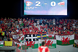 NOVI SAD, SERBIA - Tuesday, September 11, 2012: Wales supporters look dejected as Serbia score the second goal during the 2014 FIFA World Cup Brazil Qualifying Group A match at the Karadorde Stadium. (Pic by David Rawcliffe/Propaganda)