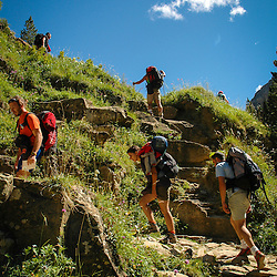 Hikers make there way up the mountain in Ordesa y Monte Perdido National Park, Spain.