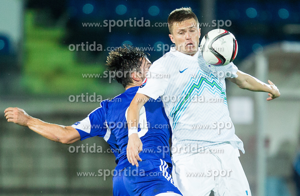 Mirko Palazzi of San Marino vs Josip Ilicic of Slovenia during football match between National teams of San Marino and Slovenia in Group E of EURO 2016 Qualifications, on October 12, 2015 in Stadio Olimpico Serravalle, Republic of San Marino. Photo by Vid Ponikvar / Sportida