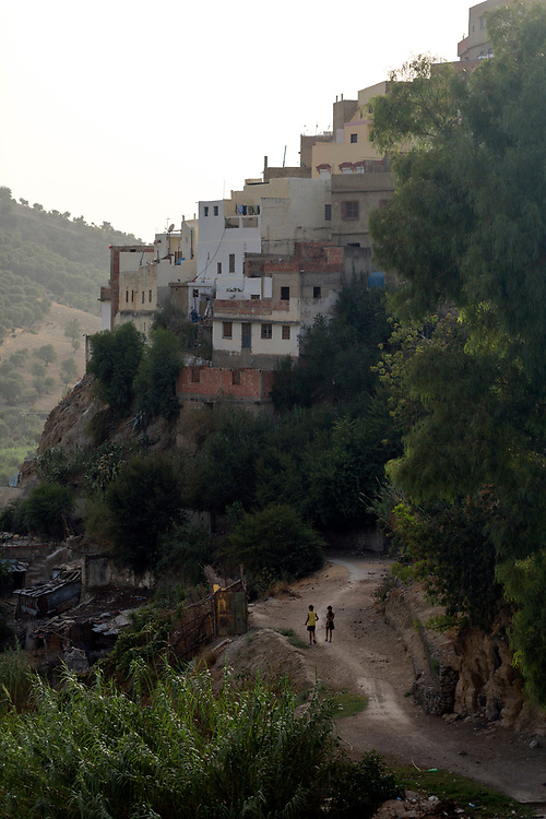 Moulay Idriss Zerhoun Medina, Middle Atlas, Morocco, 2016-08-28.<br /><br />Located nearby to Meknes and spread across the slopes of Jebel Zerhoune, Moulay Idriss holds a sacred aspect for many Moroccans; it is the burial place for Moulay Idriss the I who originally brought the religion of Islam to Morocco. The large green tiled mausoleum and mosque is located at the centre of it's Medina, which is located only 3km away from the UNESCO protected Volubilis Roman ruins.