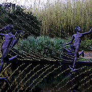 Brookgreen Gardens, in Murrells Inlet, South Carolina, is a sculpture garden and wildlife preserve which includes several themed gardens with American figurative sculptures and trails of nature reserves on the 9,100 acre property.  It was founded by Archer Milton Huntington and his wife Anna Hyatt Huntington to feature sculptures by Anna and her sister Harriet Hyatt along with other American Sculptors.   I was built on a former rice plantation - Brookgreen Plantation.  During the Christmas season many of the sculptures and live oak trees are dressed in brilliant lights.  It is one of the most popular attractions in South Carolina. These are muses playing in a fountain.