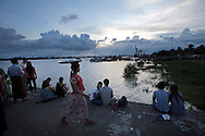 YANGON, MYANMAR - SEPTEMBER 15, 2012.Couples sit on waterfront during sunset in Yangon, Myanmar on Sep 15, 2012..After nearly five decades where the military had tight control over people's lives, the arrival of democracy has led to debates about a new national identity for the country..(Photo by Kuni Takahashi)
