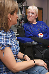 Day Care Assistant with woman with Cerebral Palsy at Day Service Centre.