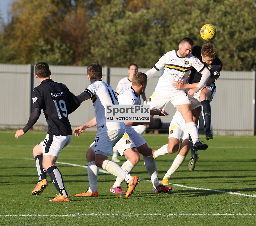 Garry Fleming clears the danger during the Dumbarton FC  v Falkirk FC Scottish Championship 24 October 2015 <br /> <br /> (c) Andy Scott | SportPix.org.uk