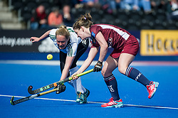 Wimbledon's Sophie Bowden is tackled by Kitty Higgins of Buckingham. Wimbledon v Buckingham - Investec Women's Hockey League Finals, Lee Valley Hockey & Tennis Centre, London, UK on 23 April 2017. Photo: Simon Parker