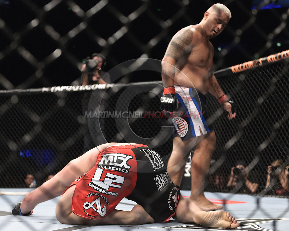"SYDNEY, AUSTRALIA, FEBRUARY 27, 2011: Mark Hunt (facing) walks away after dowing Chris Tuchscherer during ""UFC 127: Penn vs. Fitch"" inside Acer Arena in Sydney, Australia on February 27, 2011."