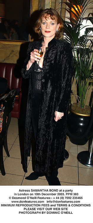 Actress SAMANTHA BOND at a party in London on 10th December 2003.PPM 383