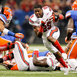 Jan 2, 2013; New Orleans, LA, USA; Louisville Cardinals running back Jeremy Wright (28) loses his helmet on a run against the Florida Gators during the first quarter of the Sugar Bowl at the Mercedes-Benz Superdome.  Mandatory Credit: Derick E. Hingle-USA TODAY Sports