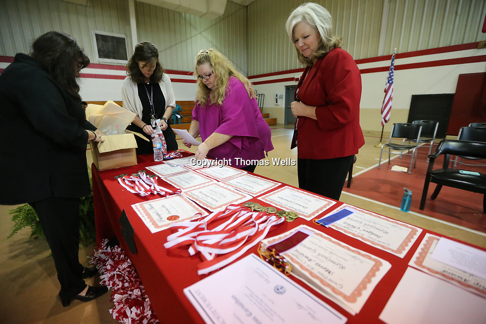 Plantersville Middle School facility arrange the awards table before Monday's Awards Day Ceremony gets started to bring the school year to a close.