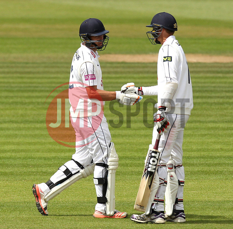 Hampshire's Gareth Berg shakes hands with Hampshire's Danny Briggs after scoring 50 - Photo mandatory by-line: Robbie Stephenson/JMP - Mobile: 07966 386802 - 23/06/2015 - SPORT - Cricket - Southampton - The Ageas Bowl - Hampshire v Somerset - County Championship Division One