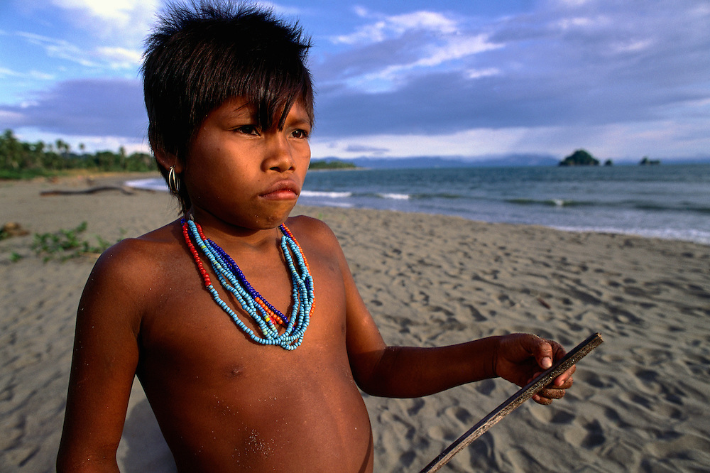 ca. 2003, Colombia --- A Choco girl stands on a beach on Colombia's Pacific coast. --- Image by © Jeremy Horner/Corbis