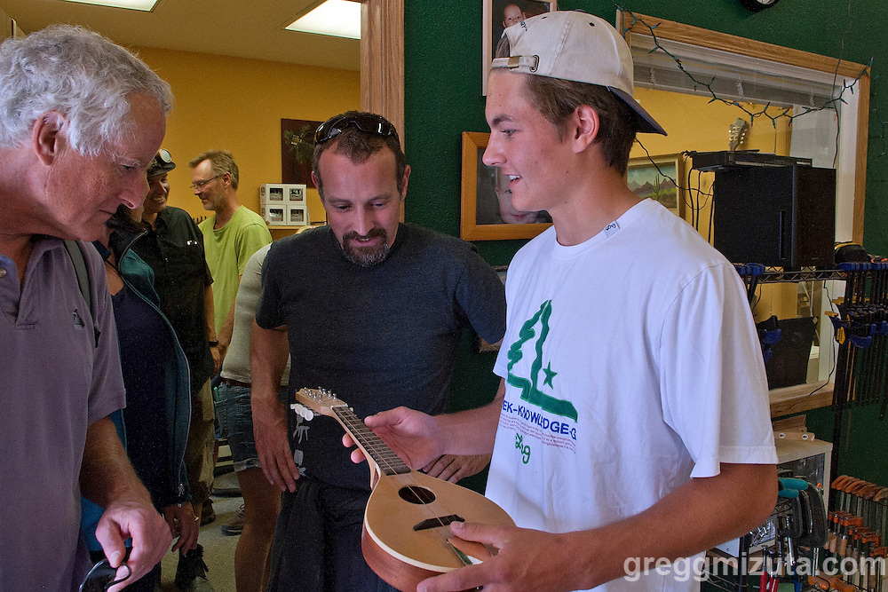 Matt Wilson shows his first mandolin, handcrafted by his father, for him when he was five. James Wilson (green shirt), owner of Garden City based Red Valley Mandolins, has been building mandolins and mandolin family instruments since 1996. Jodi Eichelberger's ST(r)EAM Artist Studio/Gallery bike tour in the Surel Mitchell Live-Work-Create District in Garden City, Idaho on June 18, 2016.<br /> <br /> Tour started at the studios of Susan Madacsi, April VanDeGrift, Erin Cunningham, and continued to Ken McCall Studios, James &amp; Matt Wilson of Red Valley Mandolins, Arin Arthur, Angie Bowling Sebolt, Belinda Isley, Matt Herberg, Lisa Roggenbuck and the Visual Arts Collective.
