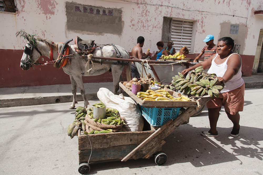 Street vendors selling fruit from carts in Santiago de Cuba, Cuba