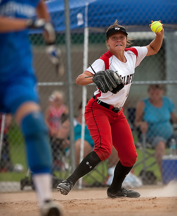 Northwest Wildfire Pitcher Jordyn McCracken wheels around to throw to first base after fielding a bunt near home plate during the Wildfire's Saturday afternoon 3-2 win against the Coeur d'Alene Crush.
