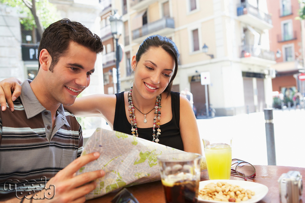 Young Couple Reading City Map