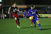 AFC Wimbledon midfielder Jake Reeves (8) is chased by Coventry City midfielder Andy Rose (6) during the EFL Sky Bet League 1 match between AFC Wimbledon and Coventry City at the Cherry Red Records Stadium, Kingston, England on 14 February 2017. Photo by Stuart Butcher.