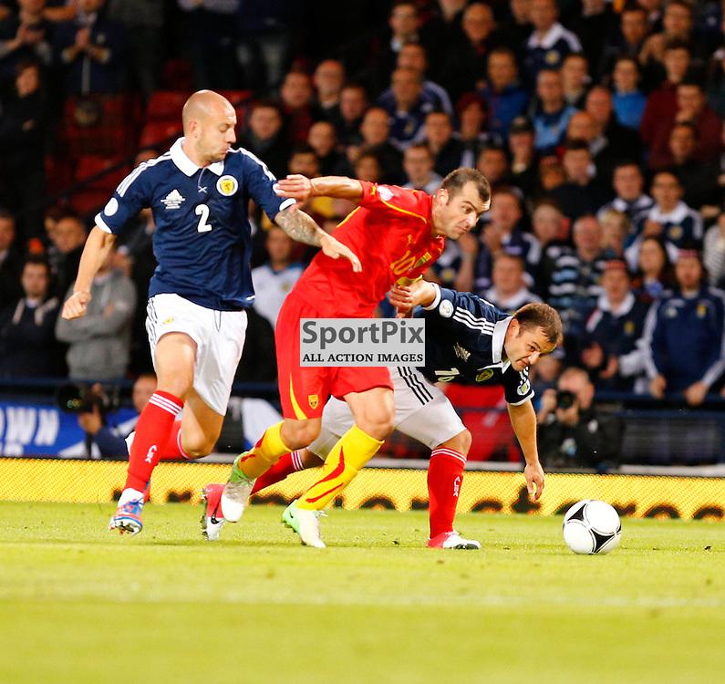 Scotland v Macedonia FIFA World Cup Qualifier..Goran Pandev pushes his way between Shaun Maloney and Alan Hutton..(c) STEPHEN LAWSON | StockPix.eu