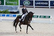 Adrienne Lyle - Wizard<br /> Alltech FEI World Equestrian Games™ 2014 - Normandy, France.<br /> © DigiShots