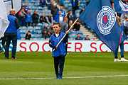 A young flag bearer ahead of the Ladbrokes Scottish Premiership match between Rangers and Aberdeen at Ibrox, Glasgow, Scotland on 27 April 2019.