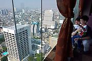 View over Bangkok from Shanghai 38 restaurant on the 38th floor of Sofitel Silom Bangkok.