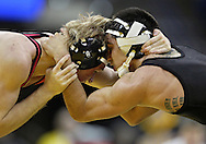 January 22 2010: Ohio State's Ian Paddock and Iowa's Tony Ramos during the 133-pound bout an NCAA wrestling dual at Carver-Hawkeye Arena in Iowa City, Iowa on January 22, 2010. Ramos defeated Paddock 5-2 and Iowa defeated Ohio State 33-3..
