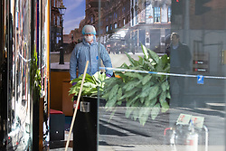 © Licensed to London News Pictures. 16/03/2020. London, UK. Forensic Officers work in a branch of Metro Bank on the Kings Road in Chelsea after a vehicle was reportedly driven into the bank . Photo credit: George Cracknell Wright/LNP