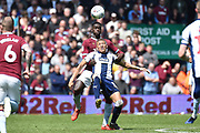 Aston Villa defender (on loan from Manchester United) Axel Tuanzebe (4) battles for possession  with West Bromwich Albion striker (on loan from Newcastle United) Dwight Gayle (16) during the EFL Sky Bet Championship first leg Play Off match between Aston Villa and West Bromwich Albion at Villa Park, Birmingham, England on 11 May 2019.