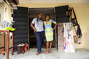 Maureen Okon (left) runs a craft shop called 'Afrocentric Afrique'.<br /> <br /> Maureen was so inspired by what she learnt, and the other women, at the Youth for Technology business training that she never went back to her consultancy job, she resigned there and then. <br /> <br /> She found the business planning and SWOT analaysis advice the most useful and she uses the business support text messages for ongoing support and motivation.