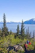 Family enjoying a hike together at McHugh Creek Recreation Area in the Chugach National Forest. Trails offer a great view over Turnagain Arm and the Chugach mountains.
