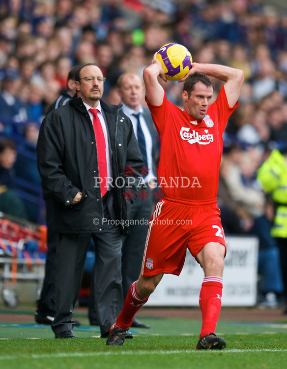 BOLTON, ENGLAND - Saturday, November 15, 2008: Liverpool's Jamie Carragher takes a throw in as manager Rafael Benitez and Bolton Wanderers' manager Gary Megson look on during the Premiership match at the Reebok Stadium. (Photo by David Rawcliffe/Propaganda)