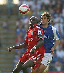 Portsmouth, England: Saturday, April 28, 2007: Liverpool's Momo Sissoko and Portsmouth's Niko Kranjcar during the Premiership match at Fratton Park (Pic by Chris Ratcliffe/Propaganda)