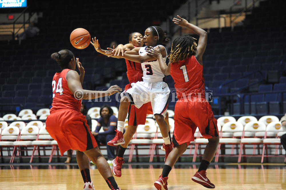 "Ole Miss' Valencia McFarland (3) vs. Lamar's Carenn Baylor (14), Lamar's Alice Robinson (24), and Lamar's Gia Ayers (1) in women's college basketball at the C.M. ""Tad"" Smith Coliseum in Oxford, Miss. on Monday, November 19, 2012.  Lamar won 85-71."