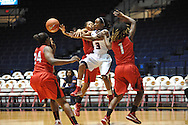 """Ole Miss' Valencia McFarland (3) vs. Lamar's Carenn Baylor (14), Lamar's Alice Robinson (24), and Lamar's Gia Ayers (1) in women's college basketball at the C.M. """"Tad"""" Smith Coliseum in Oxford, Miss. on Monday, November 19, 2012.  Lamar won 85-71."""