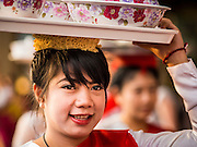 "14 JANUARY 2015 - BANGKOK, THAILAND:  Women walk in the 2015 Discover Thainess parade. The Tourism Authority of Thailand (TAT) sponsored the opening ceremony of the ""2015 Discover Thainess"" Campaign with a 3.5-kilometre parade through central Bangkok. The parade featured cultural shows from several parts of Thailand. Part of the ""2015 Discover Thainess"" campaign is a showcase of Thailand's culture and natural heritage and is divided into five categories that match the major regions of Thailand – Central Region, North, Northeast, East and South.    PHOTO BY JACK KURTZ"