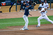 Ben Revere (11) of the Minnesota Twins is thrown out at 1st base during a game against the Tampa Bay Rays on August 10, 2012 at Target Field in Minneapolis, Minnesota. Carlos Pena (23) of the Tampa Bay Rays makes the catch at 1st base.  The Rays defeated the Twins 12 to 6.  Photo: Ben Krause