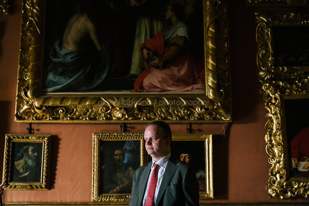 FLORENCE, ITALY - 3 JUNE 2018: Uffizi Director Eike Schmidt poses for a portrait in the Hall of Saturn at Palazzo Pitti before overseeing the transportation of dual portraits of Agnolo Doni and his wife Maddalena Strozzi, painted by Raphael, to their new location at room 41 of the Uffizi, in Florence, Italy, on June 3rd 2018.<br /> <br /> As of Monday June 4th 2018, Room 41 or the &ldquo;Raphael and Michelangelo room&rdquo; of the Uffizi is part of the rearrangement of the museum's collection that has<br /> been defining Uffizi Director Eike Schmidt&rsquo;s grander vision for the Florentine museum.<br /> Next month, the museum&rsquo;s Leonardo three paintings will be installed in a<br /> nearby room. Together, these artists capture &ldquo;a magic moment in the<br /> first decade of the 16th century when Florence was the cultural and<br /> artistic center of the world,&rdquo; Mr. Schmidt said. Room 41 hosts, among other paintings, the dual portraits of Agnolo Doni and his wife Maddalena Strozzi painted by Raphael round 1504-1505, and the &ldquo;Holy Family&rdquo;, that Michelangelo painted for the Doni couple a year later, known as the<br /> Doni Tondo.