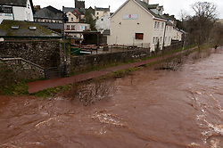 © Licensed to London News Pictures. 09/02/2020. Brecon, Powys, Wales, UK.After heavy rainfall from storm Ciara, the water level of the river Usk in Brecon has risen dramatically today. Photo credit: Graham M. Lawrence/LNP
