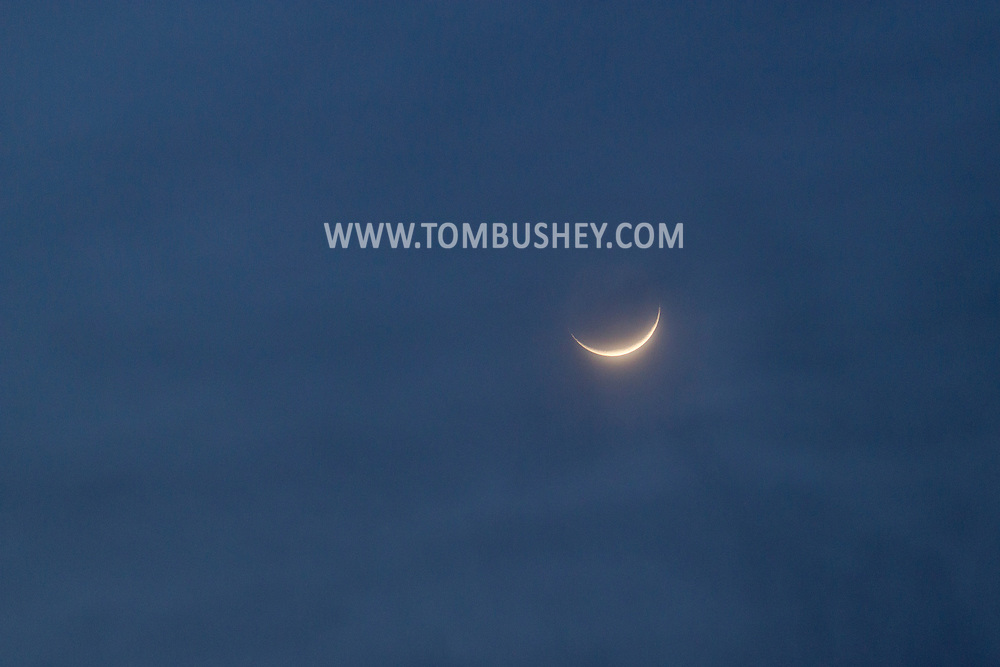 Mamakating, New York -The crescent moon and clouds on Feb. 1, 2014.