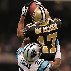 2008 December, 28:New Orleans Saints wide receiver Robert Meachem (17) makes a catch over Carolina Panthers cornerback Ken Lucas (21) during a week 17 game between NFC South divisional rivals the Carolina Panthers and the New Orleans Saints at the Louisiana Superdome in New Orleans, LA.