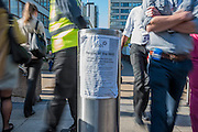 A statement from teh BMA is stuck to a security bollard in the entrance - The picket line at St Thomas' Hospital. Junior Doctors stage a 7 day all out strike action, this time imncluding accident and emergency coverage. They are striking against the new contracts due to be imposed by the Governemnt and health minister Jeremy Hunt. They are supported by the British Medical Association.