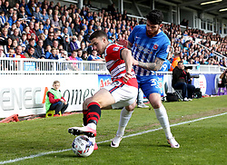 Liam Donnelly of Hartlepool United challenges Tommy Rowe of Doncaster Rovers - Mandatory by-line: Robbie Stephenson/JMP - 06/05/2017 - FOOTBALL - The Northern Gas and Power Stadium (Victoria Park) - Hartlepool, England - Hartlepool United v Doncaster Rovers - Sky Bet League Two