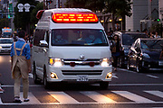 Many ambulances were kept busy treating heatstroke victims and other medical emergencies at the Tenjin Festival in Osaka.