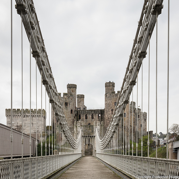 Conwy Suspension Bridge, designed by Thomas Telford in 1822–26 is one of the first road suspension bridges in the world, Conwy.