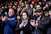Southend supporters during the one minutes applause for 14 year old Lilly Whythe during the EFL Sky Bet League 1 match between Southend United and Burton Albion at Roots Hall, Southend, England on 22 February 2020.