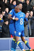 AFC Wimbledon midfielder Liam Trotter (14) and AFC Wimbledon midfielder Jimmy Abdou (8) celebrating during the EFL Sky Bet League 1 match between AFC Wimbledon and Southend United at the Cherry Red Records Stadium, Kingston, England on 1 January 2018. Photo by Matthew Redman.