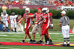 08 September 2007: Redbird captains reach out to the Racers captains just after the coin toss.  Left to right are Luke Drone, Dave Mordis, and Kye Stewart. The Murray State Racers were defeated by the Illinois State Redbirds 43-17 in a nightcap at Hancock Stadium on the campus of Illinois State University in Normal Illinois.