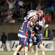 Will Manny #1 of the Boston Cannons is congratulated by other members of the Boston Cannons during the game at Harvard Stadium on May 10, 2014 in Boston, Massachusetts. (Photo by Elan Kawesch)